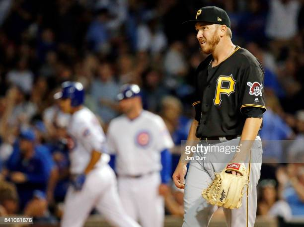 J Schugel of the Pittsburgh Pirates reacts after giving up a single to Jose Quintana of the Chicago Cubs during the fifth inning at Wrigley Field on...