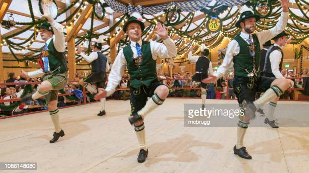 schuhplattler at the octoberfest - munich stock pictures, royalty-free photos & images