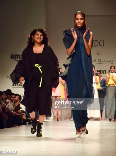Schulen Fernandes Creative Director of designer Wendell Rodricks' eponymous label with a model in her Indigofera collection at the Fashion Design...