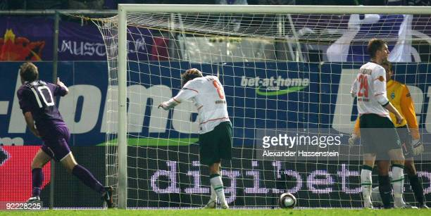 Schumacher of Vienna scores his team's second goal while Clemens Fritz of Bremen reacts during the UEFA Europa League Group L match between Austria...