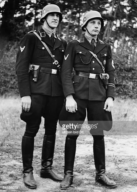 SS Schutzstaffel of the NSDAP Nazi Party Untersturmfuehrer Kretschmann and Untersturmfuehrer Hildebrandt of the Berlin Gestapo in uniform...