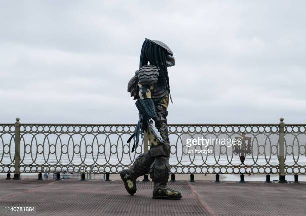 Sci Fi fan dressed as the character Predator attends the first day of the Scarborough Sci-Fi weekend at the seafront Spa Complex on April 06, 2019 in...
