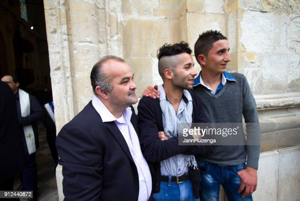 scicli (ragusa province), sicily: portrait three men outside church - happy easter in italian stock pictures, royalty-free photos & images