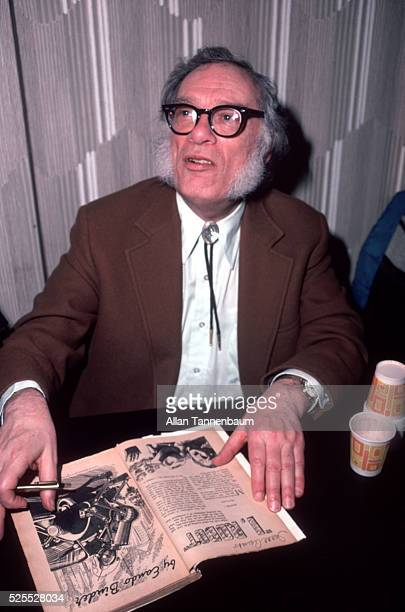 Science Fiction author Isaac Asimov at a Science Fiction convention autographs a vintage copy of 'I Robot' New York New York March 28 1982