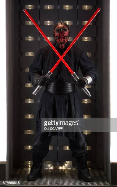 A science fiction fan dressed as Darth Maul from Star Wars attends the 'For the Love of Scifi' convention in Manchester north west England on...