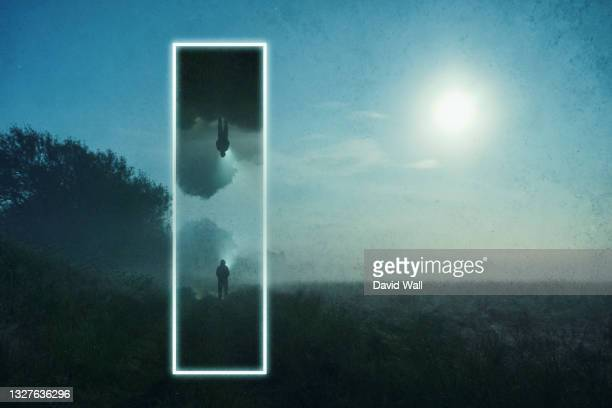 a science fiction graphic design concept of a glowing portal. with a mysterious figure mirrored in a misty spooky landscape at night. - door stock pictures, royalty-free photos & images
