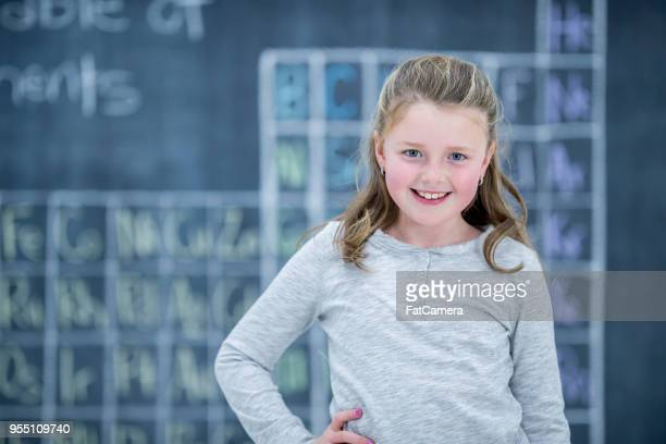 science girl at school - periodic table stock photos and pictures