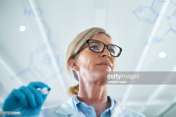 science is one of the most important channels of knowledge - forensicpathologist stock pictures, royalty-free photos & images