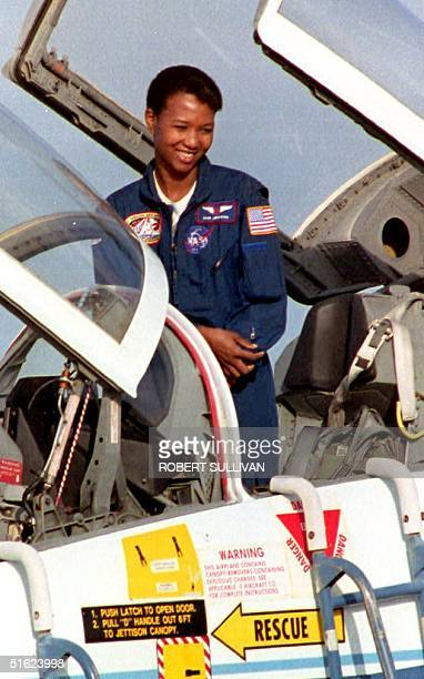 Science Mission Specialist Mae Jemison prepares to climb out of her T38 training jet 09 September 1992 after arriving at the Kennedy Space Center...