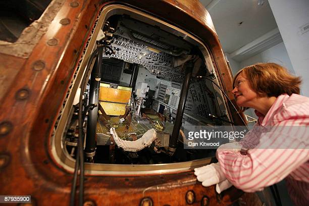 Science Museum employee Molly Jackson poses for a photograph with the Apollo 10 command module on May 23 2009 in London England The space capsule was...