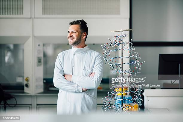 Science student with DNA model in laboratory