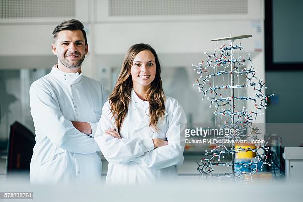 Science students with DNA model in laboratory