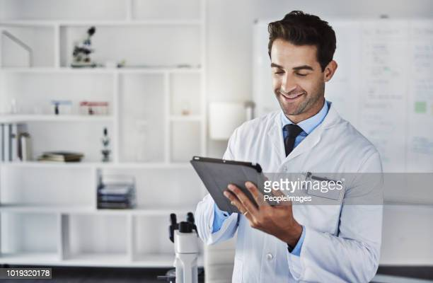 science sure has advanced a long way - lab coat stock pictures, royalty-free photos & images