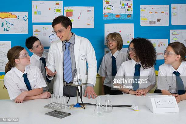 science teacher and pupils - bunsen burner stock pictures, royalty-free photos & images