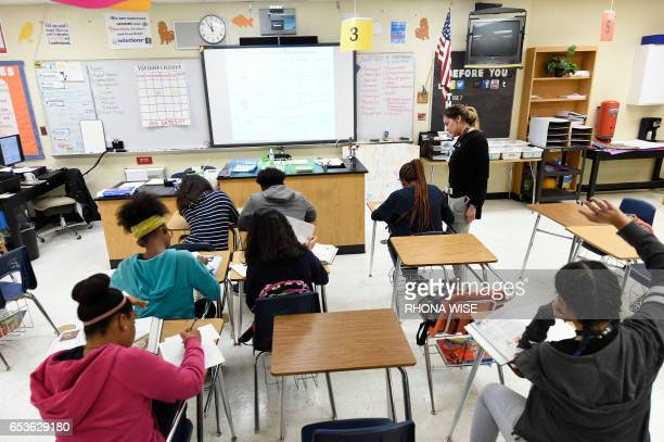CORRECTION Science teacher Virginia EscobarCheng works with her students in a science class in a high school in Homestead Florida on March 10 2017...