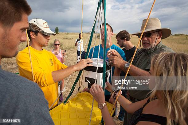 science team prepares pollution testing equipment colorado - weather balloon stock pictures, royalty-free photos & images