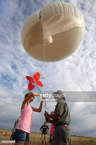 science team prepares weather balloon instruments colorado - weather balloon stock pictures, royalty-free photos & images