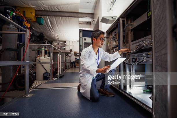 science technician - physics stock pictures, royalty-free photos & images