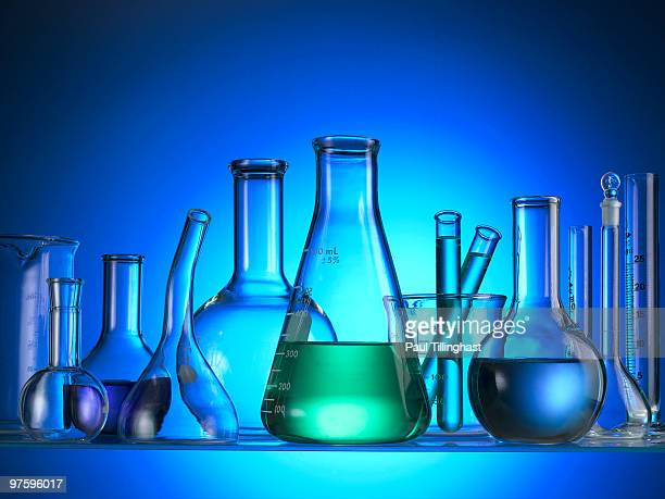 Science test tubes beakers blue background