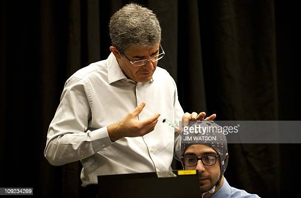 RESEARCHJose del R Millan director of EPFL Chair in NonInvasive BrainMachine Interfaces injects hydogel into the skull cap of doctoral student...
