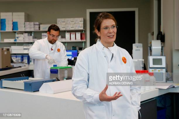 Scientific coordinator Aude Echalier speaks in the laboratory of British pharmatech company Exscientia at Oxford Science Park in Oxford, in southern...