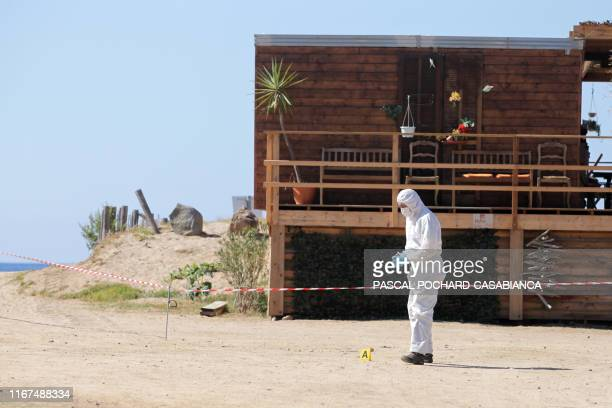 Scientific gendarme works on the crime scene at the beach restaurant where the owner, member of the nationalist movement Core in Fronte , Maxime...
