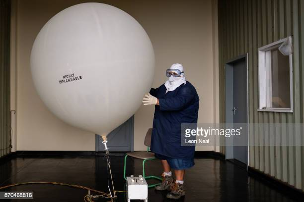 Scientific Observation Officer Garry Mercury prepares the daily weather balloon for launch at the Met Office base near St Helena airport on October...