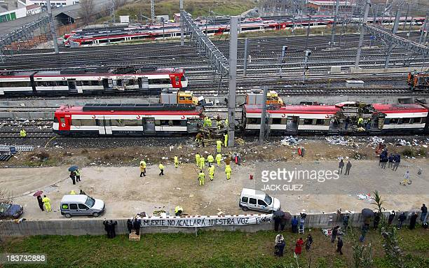 Scientific police and rail workers work 12 March 2004 on the trains which exploded at the Atocha train station the day before At least 198 people...