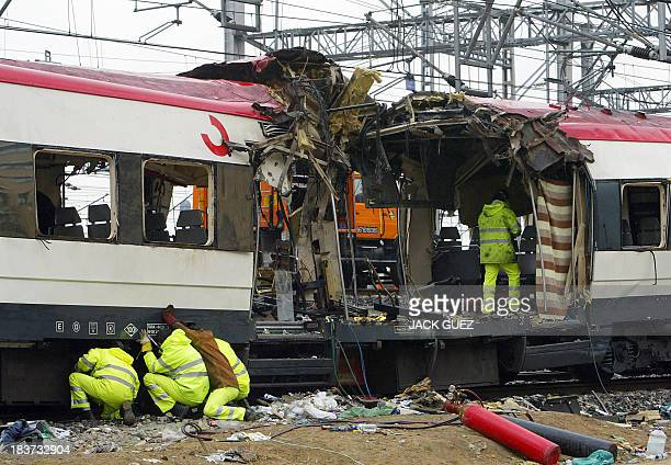 Scientific police inspect 12 March 2004 the train which exploded at the Atocha train station the day before At least 198 people were killed and more...