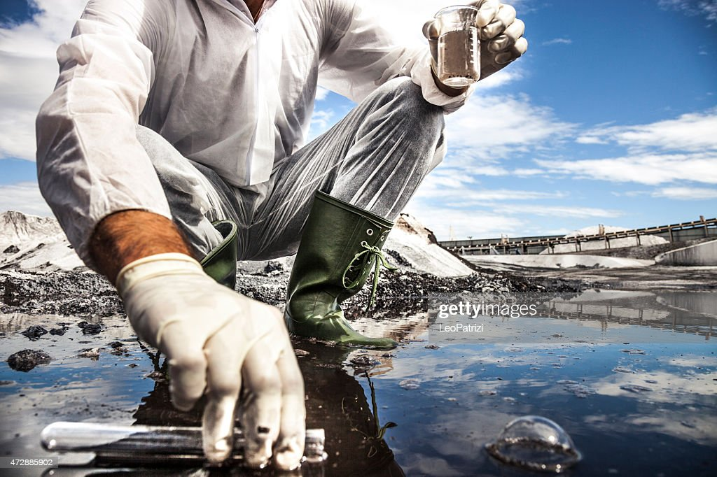 Scientist analyze the water of a river : Stock Photo