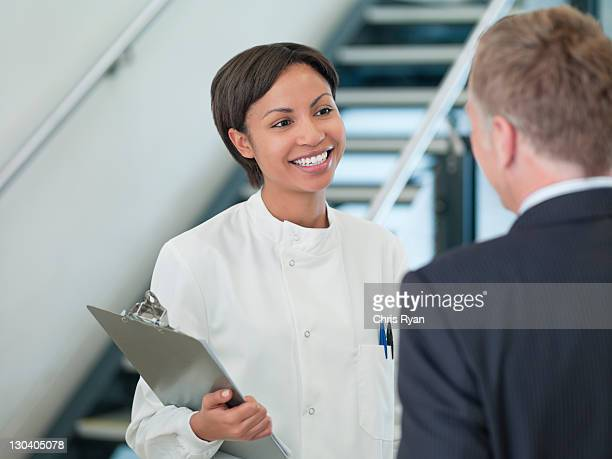 Scientist and businessman talking in office