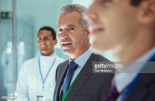 Scientist and businessmen in laboratory