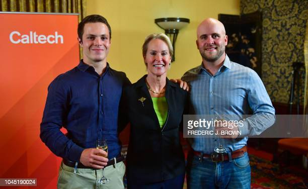 Scientist and Nobel Prize winner Frances Arnold and her sons Joe Lange and James Bailey pose on October 3 2018 at Caltech in Pasadena following a...