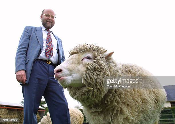 Scientist and Professor Ian Wilmut and Dolly the world's first cloned sheep at the Roslin Institute near Edinburgh where Dolly was developed and...