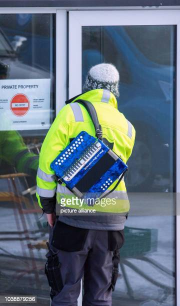 A scientist carrying an accordeon heads to the Kings Bay research station's central cafeteria on Spitsbergen in NyAelesund Norway 10 April 2015...