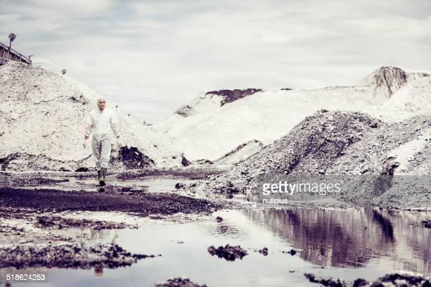 scientist checking pollution levels in deserted landscape