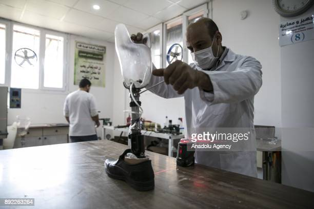 A scientist controls a prosthetic leg for Syrians who lost their upper and lower extremities due to the ongoing civilwar at a medical center in...