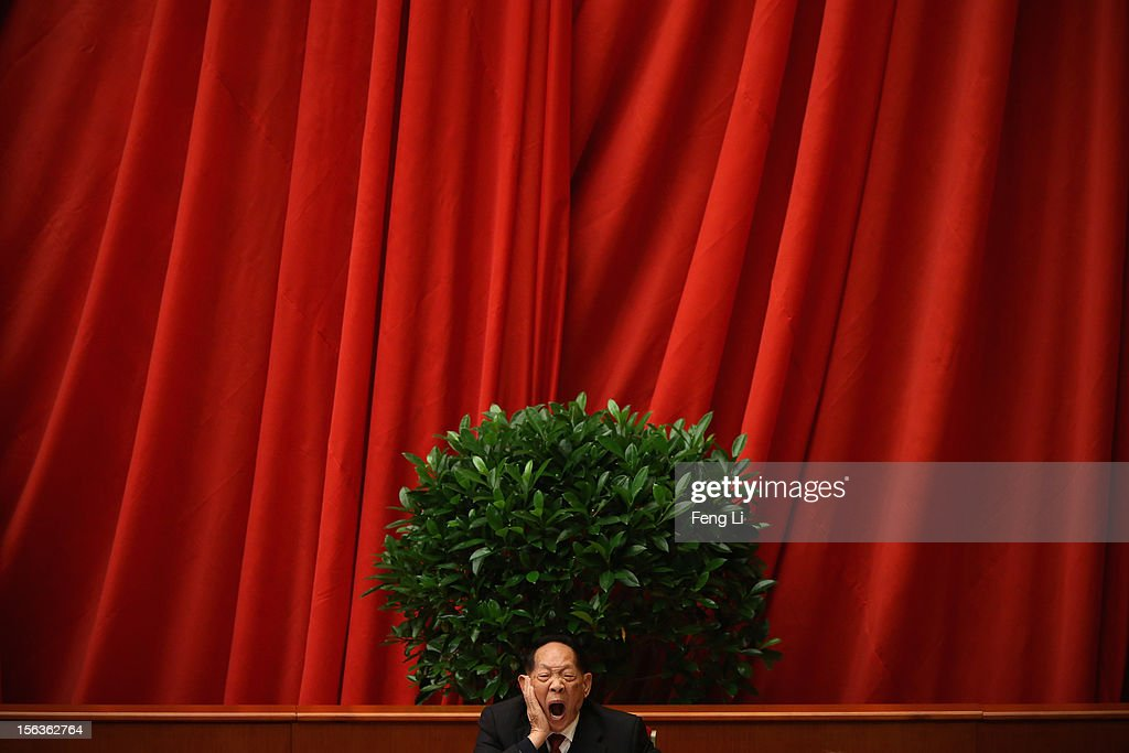 A scientist delegate yawns at stage during the closing session of the 18th National Congress of the Communist Party of China (CPC) inside the Great Hall of the People on November 14, 2012 in Beijing, China. Members of the Standing Committee of the Political Bureau of the new CPC Central Committee will meet with journalists on November 15, 2012.