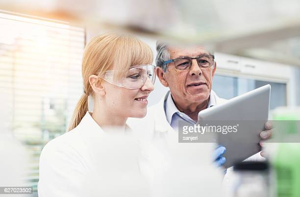 Scientist Discussing Using Digital Tablet