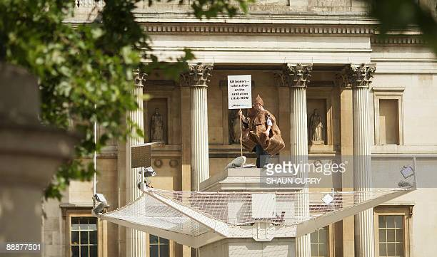 A scientist dressed as a giant poo stands on the Fourth Plinth in Trafalgar Square as part of the Antony Gormley's 'One Other' project in central...