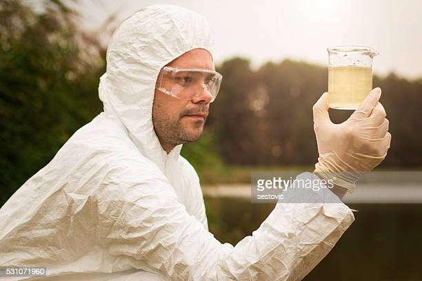 Scientist examing toxic water
