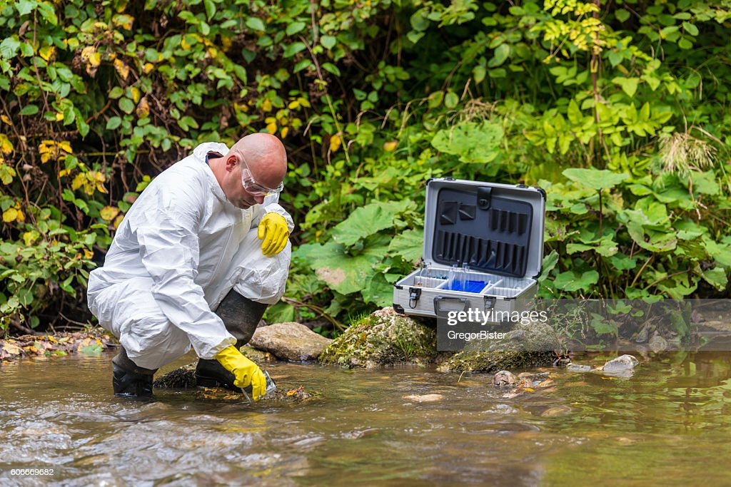 Scientist examing toxic water : Stock Photo