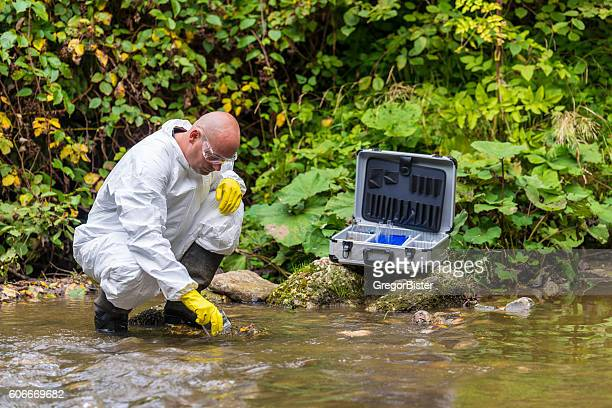 scientist examing toxic water - environment stock pictures, royalty-free photos & images