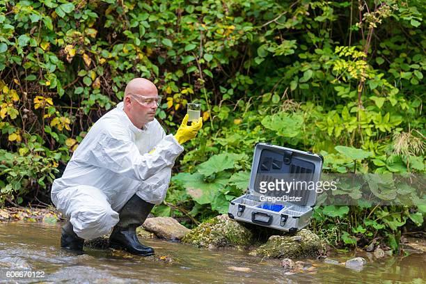 Scientist examing toxic water