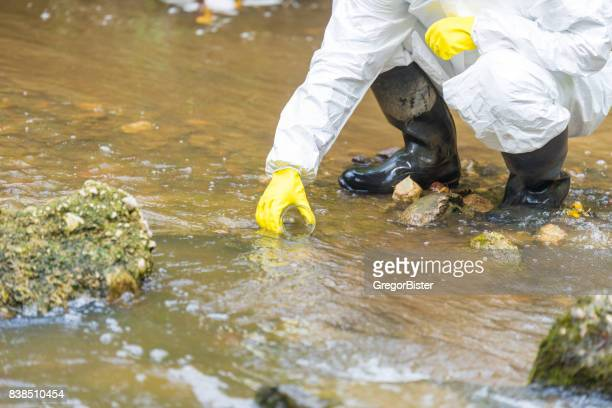 scientist examing toxic water - medical test stock pictures, royalty-free photos & images