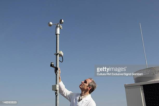 scientist examining air metereology - sigrid gombert stock pictures, royalty-free photos & images