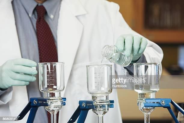 Scientist filtering a sample