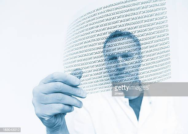Scientist holding a digital rendition of a DNA code