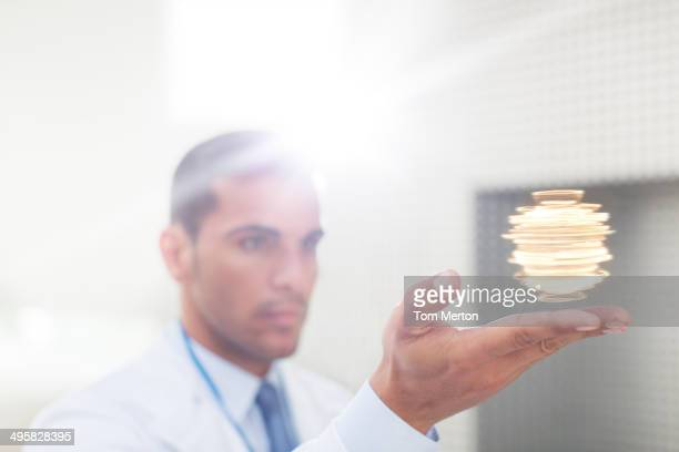 Scientist holding molecule model