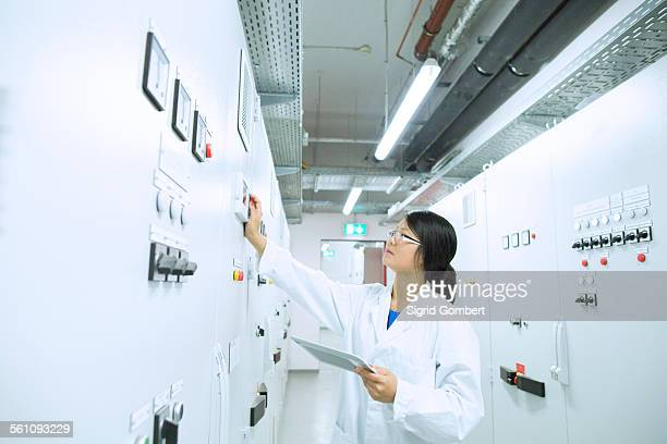 scientist in control room - sigrid gombert stock pictures, royalty-free photos & images